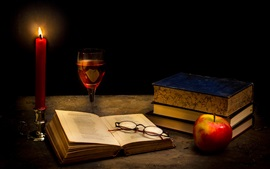 Preview wallpaper Tranquillity dark, candle, books, glass, apple