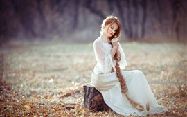 Preview wallpaper White dress girl, sitting on stump, long blonde hair