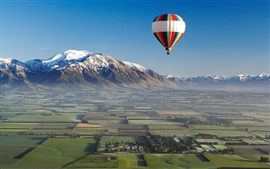 Preview wallpaper Hot air balloon, sports, mountains, field