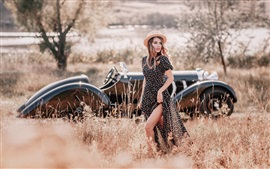 Retro style, girl in grass, hat, car