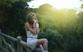 Preview wallpaper Beautiful blonde girl in dream, sitting at fence, morning