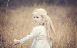 Preview wallpaper Cute little girl, blonde, wind, grass