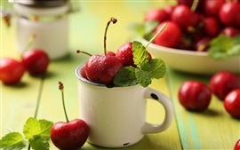 Preview wallpaper Fresh fruits, red cherries, mug, leaves