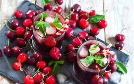 Many red cherries, mint, ice, drink