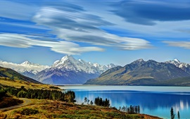 Preview wallpaper New Zealand, Lake Pukaki, mountains, trees, clouds
