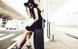 Preview wallpaper Asian girl, sunglass, suitcase, roadside