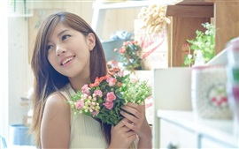 Beautiful Asian girl, holding flowers