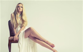 Preview wallpaper Beautiful girl, blonde, long dress, sitting at chair, legs