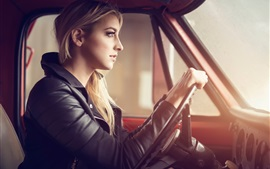 Blonde girl driving car