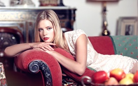 Preview wallpaper Blonde girl lying on sofa