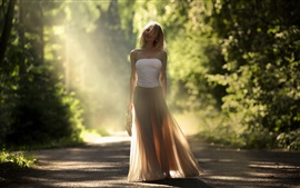 Preview wallpaper Girl at road, trees, sunlight, glare, wind