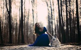 Happy girl, blue dress, dog, trees