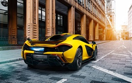 Preview wallpaper McLaren P1 yellow supercar rear view, city