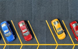 Parking area top view, pavement, yellow lines, yellow red blue cars