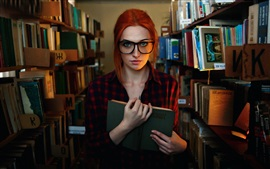 Preview wallpaper Red hair girl, freckles, glasses, library, reading book