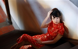 Preview wallpaper Beautiful red cheongsam girl in the room