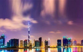 Beautiful night in Dubai, Burj Khalifa, high-rise buildings, lights, water