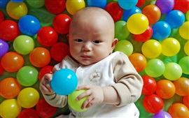Preview wallpaper Cute baby in play balls