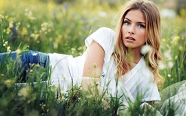 Blonde girl lying the grass, summer
