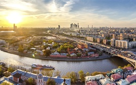 Preview wallpaper Downtown Moscow, sunset, river, bridge, buildings, Russia
