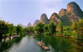 Preview wallpaper Guilin, Yangshuo beautiful landscape, mountains, trees, river, bamboo raft, China