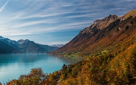 Preview wallpaper Lake, mountains, village, slope, water, trees, clouds