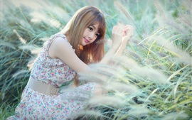 Preview wallpaper Asian girl in the grass, long hair, face, eyes, summer