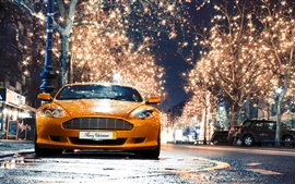 Aston Martin DB9 orange supercar front view, night, lights