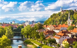 Preview wallpaper Beautiful Ljubljana city in Slovenia, houses, river, trees, mountains, clouds