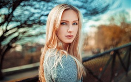 Blonde girl look back, blue eyes, bokeh
