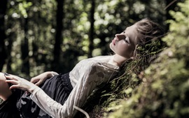 Preview wallpaper Blonde girl sleeping in forest, relaxation