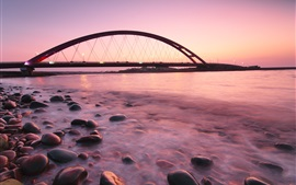 Preview wallpaper Bridge, coast, stones, sea, lights, dusk, red sky
