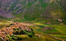 Preview wallpaper Castelluccio, Italy, village, houses, fields, mountains, slope