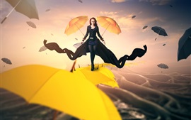 Creative pictures, girl walks on the umbrellas top