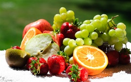 Delicious fruits, oranges, kiwi, grapes, strawberries