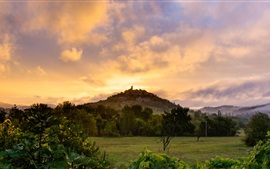 France, Midi-Pyrenees, mountain, fields, trees, bushes, clouds, dawn