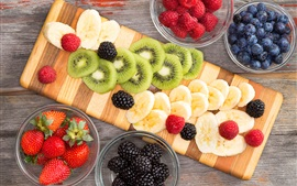 Fruit slice, kiwi, banana, strawberries, blackberries, blueberries