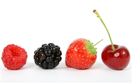 Fruits close-up, raspberry, blackberry, strawberry, cherry, white background