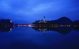Preview wallpaper Lake Bled in Slovenia, night, lights, water reflection