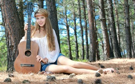 Long hair girl in forest, guitar, music