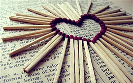Matches, newspaper, love heart