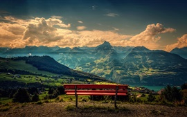 Mountains, clouds, river, trees, villages, red bench