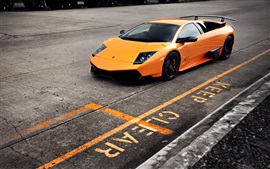 Orange Lamborghini Murcielago LP670-4 SV supercar at road