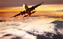 Preview wallpaper Passenger plane flying on clouds top