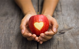 Preview wallpaper Red apple in hand, love heart shaped
