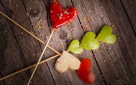 Preview wallpaper Red apples slices, love hearts, candy, wood board