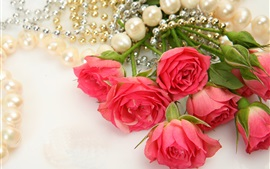 Red flowers, roses, pearl necklace