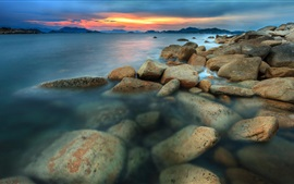 Preview wallpaper Sea, coast, sunset, rocks, clouds, dusk