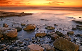 Sunset coast, stones, sea, red sky