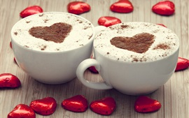 Two cups cappuccino coffee, love hearts chocolate